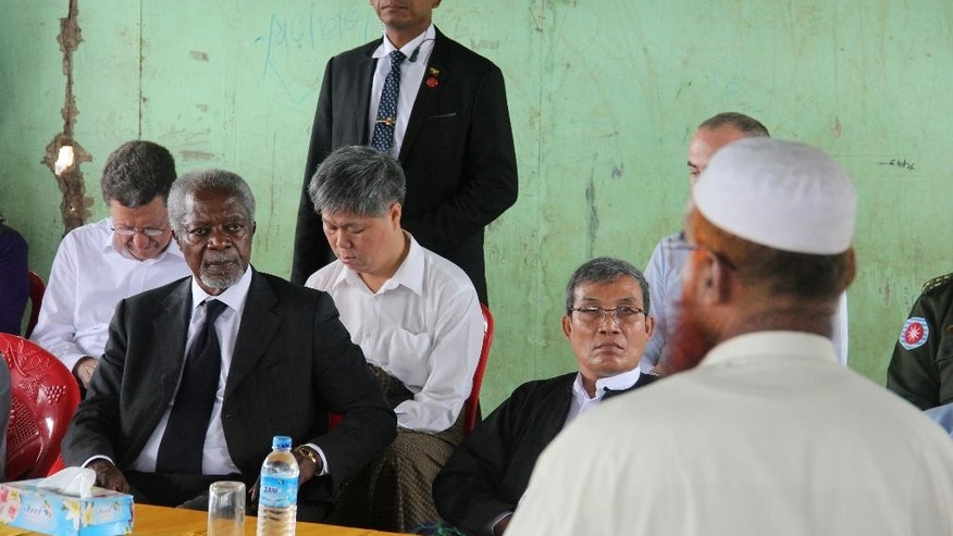 "Former United Nations Secretary-General Kofi Annan, second left, listens to a Rohingya religious and community leader as he is explained the situation in the Internally Displaced People's camps as the Rakhine Advisory Commission visits a camp in Thetkabyin village, outside Sittwe, the capital of Rakhine state.  Annan is visiting as part of a commission set up last month to help find solutions to ""protracted issues"" in western Rakhine state, where human rights groups have documented widespread abuses by majority Rakhine Buddhists against minority Rohingya Muslims. (AP Photo/Esther Htusan)"