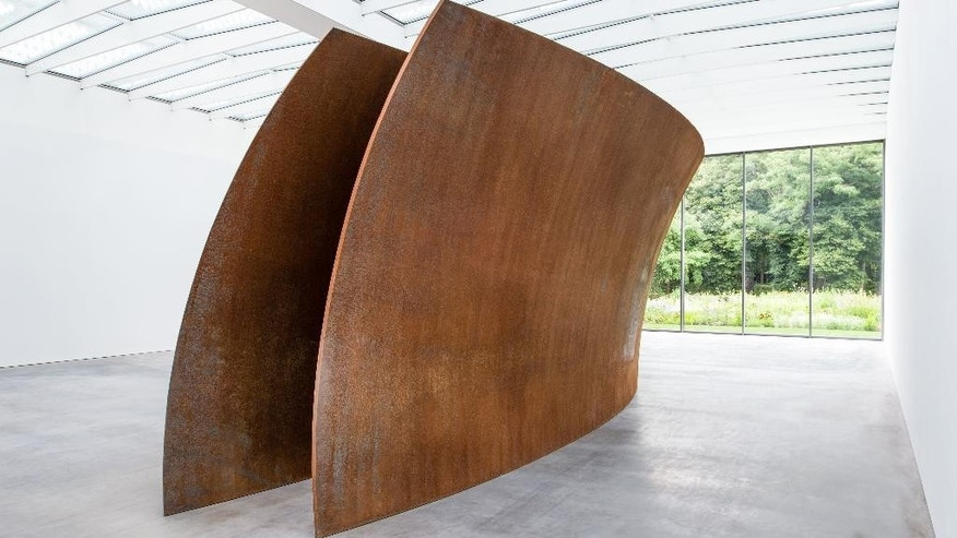 "In this undated handout picture, ""Open Ended"" sculpture by U.S artist Richard Serra at the new Museum Voorlinden in Wassenaar, Netherlands. The 216-ton walk-through sculpture is one of the permanent exhibits at the museum that opens its doors to the public on Sept. 11, 2016 to showcase the eclectic collection of modern and contemporary art amassed by wealthy Dutch industrialist Joop van Caldenborgh.  (Antoine van Kaam/ Museum Voorlinden via AP)"