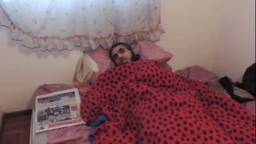 "In this screen shot of a video taken on Tuesday, Sept. 6, 2016 provided by the ""Vigilia por Jihad Deyab"" group, Syria's Abu Wa'el Dhiab talks to the camera from bed during his hunger strike in Montevideo, Uruguay. Uruguay's government said Wednesday that it is searching for another country to take the former Guantanamo detainee who is threatening to die on a hunger strike if he is not allowed to reunite with his family abroad. (Vigilia por Jihad Deyab via AP)"