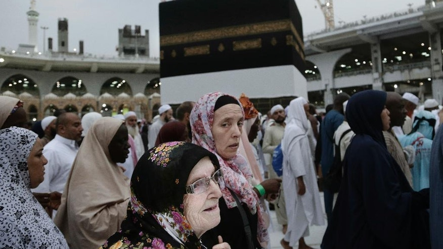 A woman holds her mother as they circle the Kaaba, Islam's holiest shrine, at the Grand Mosque in the Muslim holy city of Mecca, Saudi Arabia, Thursday, Sept. 8, 2016. Muslim pilgrims have begun arriving at the holiest sites in Islam ahead of the annual hajj pilgrimage in Saudi Arabia, with some weeping with their hands outstretched for a fleeting touch of the Kaaba. The cube-shaped shrine, at the center of Mecca's Grand Mosque, is the site the world's 1.6 billion Muslims pray toward five times a day. (AP Photo/Nariman El-Mofty)
