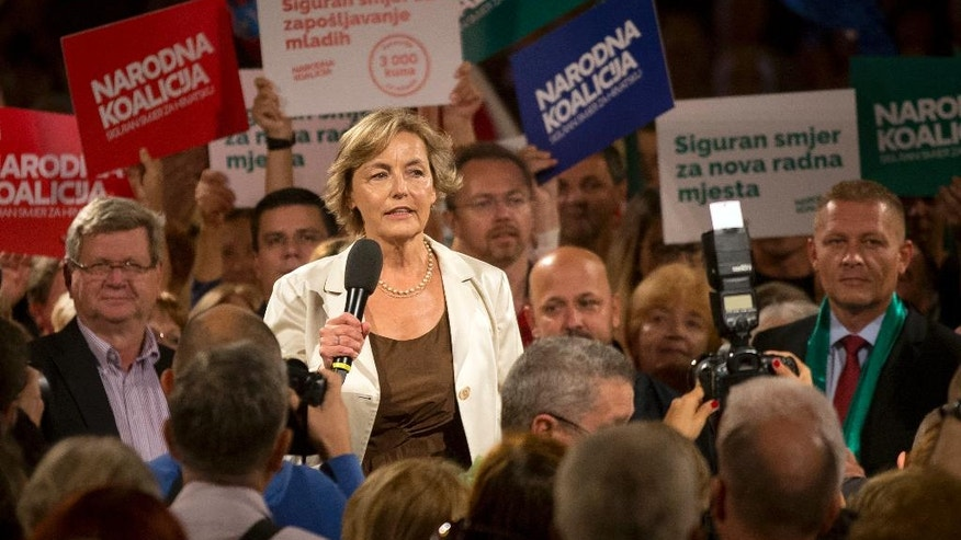 In this photo taken late Wednesday, Sept. 7, 2016, Vesna Pusic, former foreign minister and one of the leaders of the center-left coalition talks to supporters at a rally in Zagreb, Croatia. Croats go to the polls this weekend in a snap election that, despite the country's many problems, has been more about past divisions than future challenges facing the European Union's newest member state. (AP Photo/Darko Bandic)