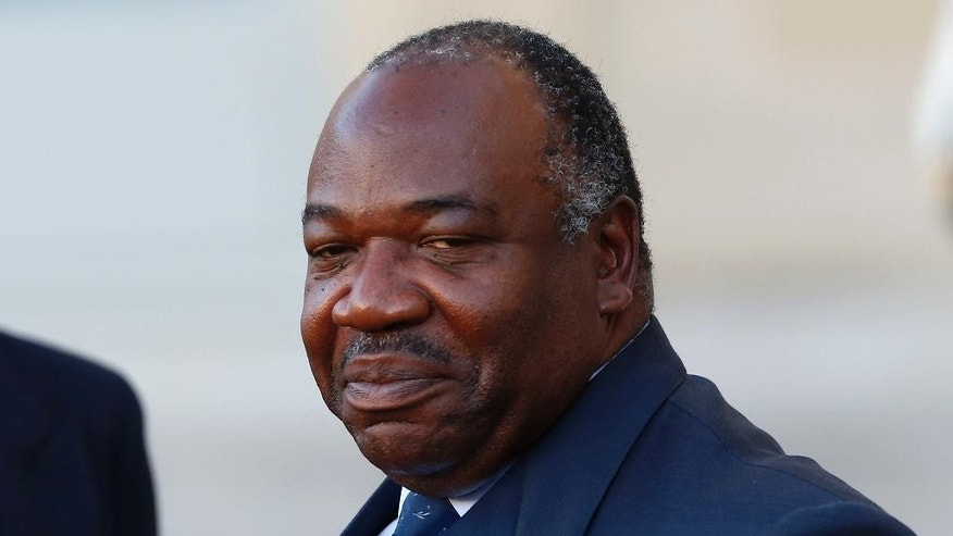 FILE-In this file photo taken on Tuesday, Nov. 10, 2015, Gabon's President Ali Bongo Ondimba, leaves the Elysee Palace after a meeting with French President Francois Hollande as part of preparation of the upcoming COP21 Climate Conference in Paris, France. President   Ondimba on Wednesday Sept. 7, 2016  tried to deflect European Union observers' findings of a voting anomaly in his stronghold province that pushed him over the edge to win re-election, accusing his lead opponent of ballot fraud and a plot to seize power. (AP Photo/Francois Mori, File)