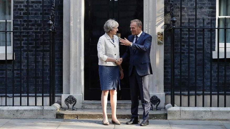 Britain's Prime Minister Theresa May, left, welcomes President of the European Council, Donald Tusk to 10 Downing Street in London, Thursday, Sept. 8, 2016. The two met for a bilateral meeting to discuss Britain's Exit of the European Union. (AP Photo/Kirsty Wigglesworth)