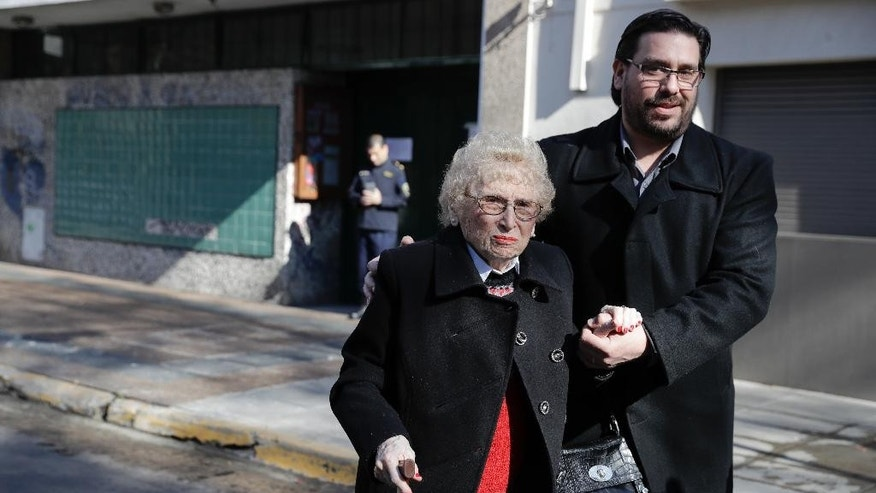 Vice President of Grandmothers of Plaza de Mayo Rosa Tarlovsky de Roisinblit, left, and her grandson Guillermo Roisinblit, walk towards the court on the verdict day of a trial investigating the former head of the Argentine Air Force and two of his former subordinates for forced disappearances during the last military dictatorship, in Buenos Aires, Argentina, Thursday, Sept. 8, 2016. Guillermo, who was born in captivity to Patricia Roisinblit during Argentina's dictatorship and raised by another family, reunited with his grandmother on 2000 after he discovered his real identity. (AP Photo/Natacha Pisarenko)