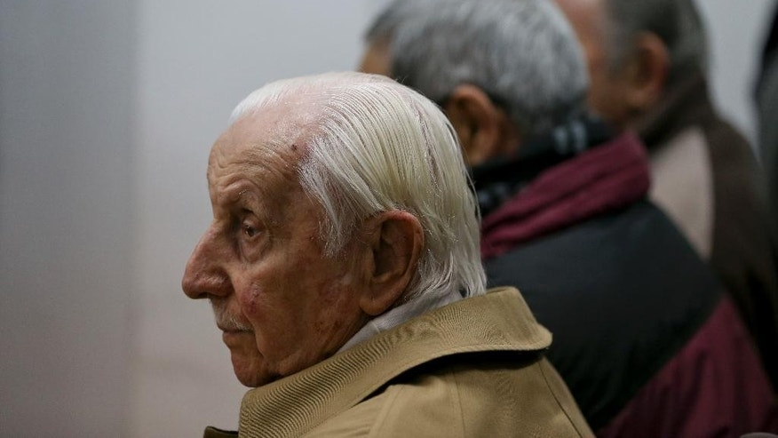 Omar Graffigna, who was head of the Air Force during Argentina's military dictatorship, attends his trial where he is accused of crimes against humanity on the verdict day in Buenos Aires, Argentina, Thursday, Sept. 8, 2016. The trial investigates Graffigna, and two of his subordinates for the forced disappearances of Patricia Roisinblit, who was eight months pregnant, and her husband Jose Manuel Perez Rojo. (AP Photo/Natacha Pisarenko)