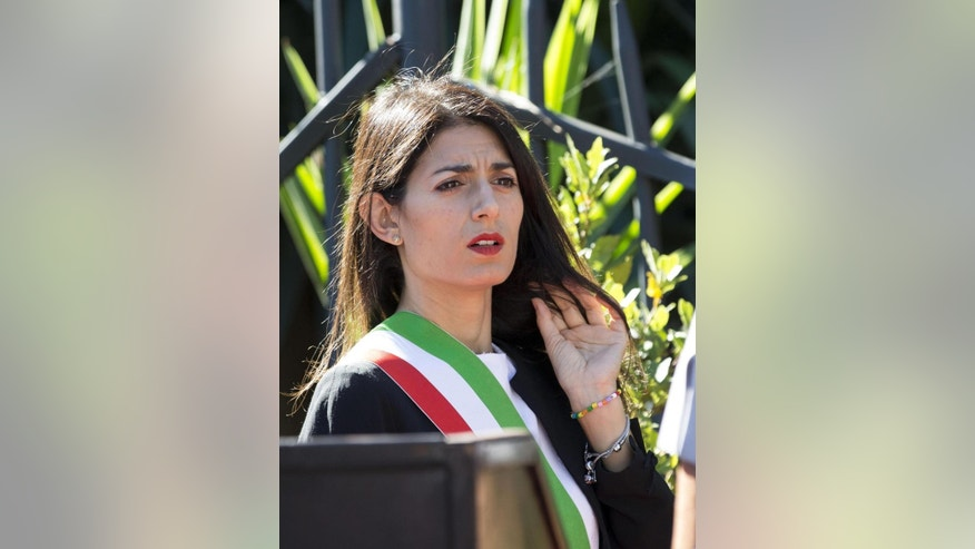 Rome's 5-Star Movement Mayor Virginia Raggi attends a ceremony for the 73rd anniversary of an Italian defense of Rome by Nazi occupation, in Rome, Thursday, Sept. 8, 2016. The leader of Italy's populist 5-Star Movement Beppe Grillo has given Rome's embattled mayor a public vote of confidence after her administration fell into disarray over a spate of resignations. (Massimo Percossi/ANSA via AP)