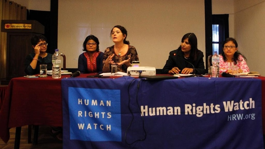 Heather Bar, center, a researcher at the New York-based Human Rights Watch speaks during the release of a report on child marriage in Nepal in Kathmandu, Nepal, Thursday, Sept. 8, 2016. Traditional practices, poverty, last year's massive earthquake and Nepal's ongoing political instability mean child marriages remain a serious problem in the country, where 10 percent of the girls marry before they are 15, even though the government says it is making progress to combat the problem, rights groups say. (AP Photo/Niranjan Shrestha)