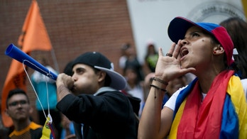 Demonstrators shout slogans against Venezuela's President Nicolas Maduro in Los Teques on the outskirts of Caracas, Venezuela, Wednesday, Sept. 7, 2016. Venezuelans are marching in cities across the country to demand authorities allow a recall referendum against Maduro to go forward this year. (AP Photo/Ariana Cubillos)