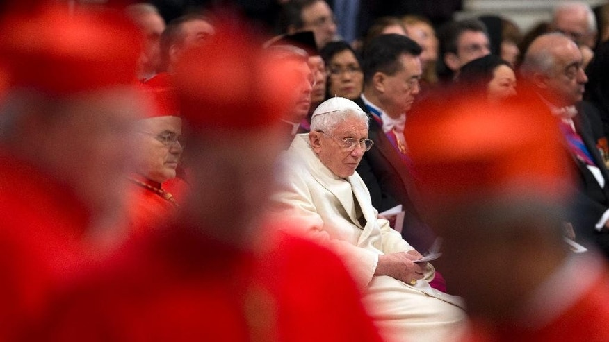 "FILE - This Feb. 14, 2015 file photo shows Pope Emeritus Benedict XVI sitting amongst cardinals during a ceremony in St. Peter's Basilica at the Vatican. Excerpts of a new book-interview, ""The Last Conversations"", by Benedict and German journalist Peter Seewald, where the retired pope offers final reflections on papacy, were published Thursday, Sept. 8, 2016 in Italy's Corriere della Sera.  (AP Photo/Andrew Medichini, files)"