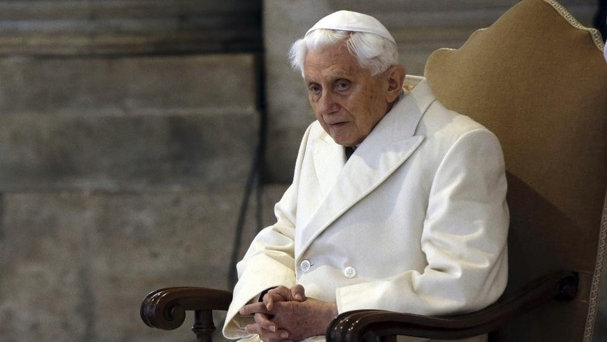 "FILE - This Dec. 8, 2015 file photo shows Pope Emeritus Benedict XVI sitting in St. Peter's Basilica as he attends the ceremony marking the start of the Holy Year, at the Vatican. Excerpts of a new book-interview, ""The Last Conversations"" by Benedict and German journalist Peter Seewald were published Thursday, Sept. 8, 2016 in Italy's Corriere della Sera where the retired pope offers final reflections on papacy.  (AP Photo/Gregorio Borgia)"