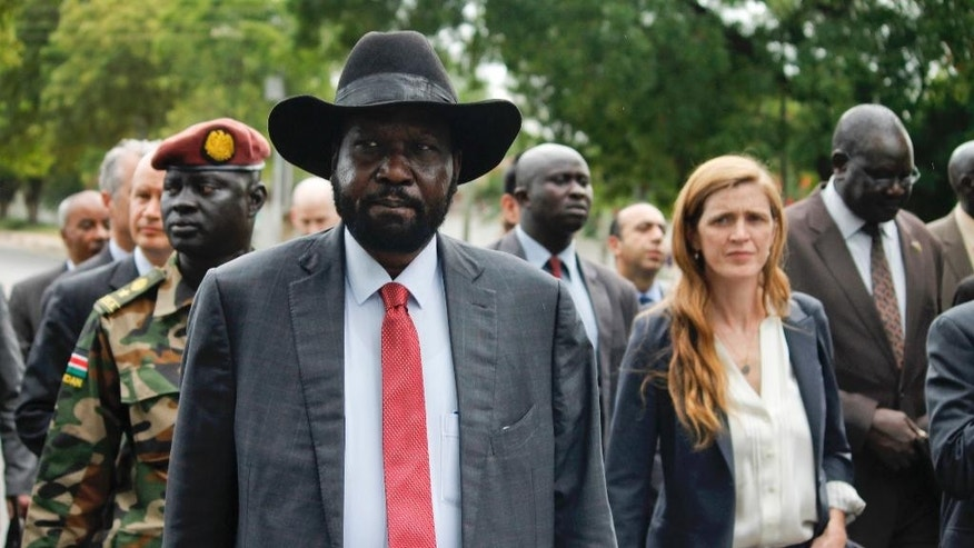 South Sudan's President Salva Kiir, left, takes members of the UN Security Council, including U.S. Ambassador to the United Nations Samantha Power, right, on a tour outside the presidential compound in the capital Juba, South Sudan, Sunday, Sept. 4, 2016. South Sudan has agreed to the deployment of a 4,000-strong regional protection force approved by the U.N. Security Council after first rejecting the peacekeepers as a violation of its sovereignty. (AP Photo/Justin Lynch)