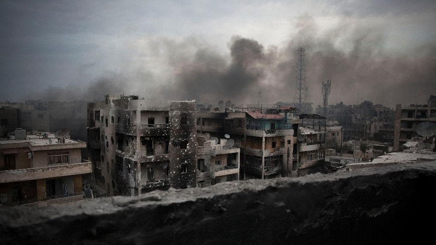 """FILE - In this Tuesday, Oct. 2, 2012 file photo, smoke rises over Saif Al Dawla district, in Aleppo, Syria. Asked what he will do about Aleppo's intractable situation, U.S Presidential candidate Gary Johnson responded in earnest: """"What is Aleppo?"""" His comments caused a debate in the U.S. about the importance of foreign policy issues in the current presidential elections.(AP Photo/ Manu Brabo, File)"""