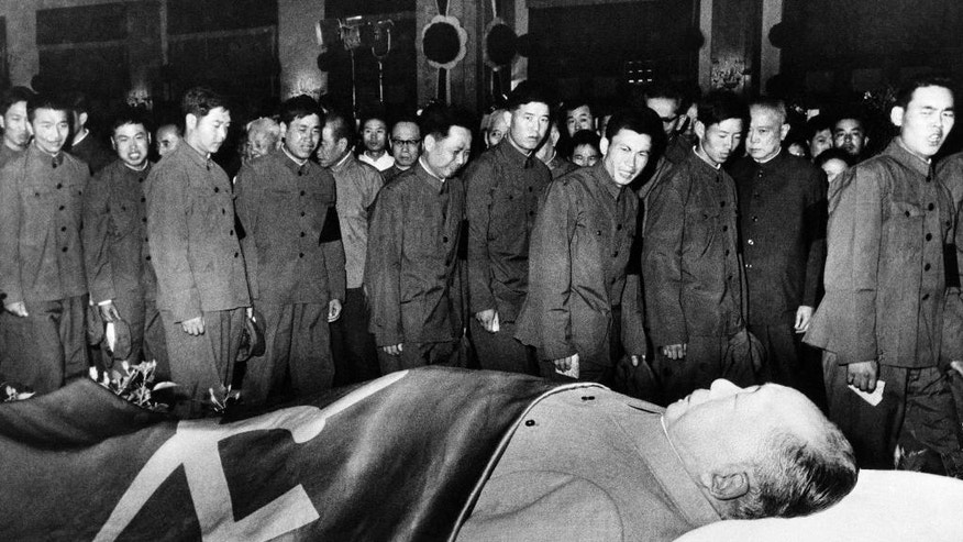 FILE - In this undated photo, members of the Chinese People's Liberation Army pay their respects to the body Mao Zedong in China. Friday, Sept 9, 2016 marks the 40th anniversary of the death of Mao Zedong, who founded the People's Republic in 1949 and ran it virtually uncontested until his death on Sept. 9, 1976. (Photo via AP, File)