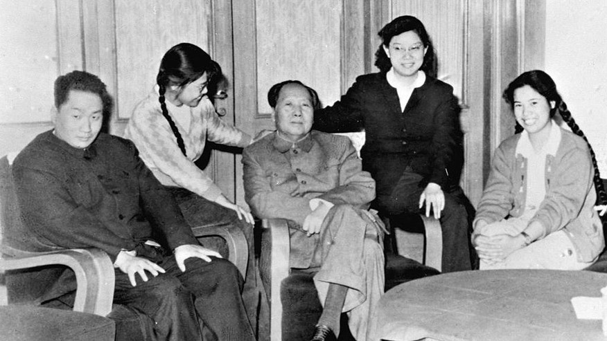 File - In the 1962, file photo released by China's Xinhua News Agency, Mao Anqing, first from left, the second son of the late founder of China's communist government, Mao Zedong, third left, and Mao Anqing's wife Shao Hua, right, pose for a family photo. Friday, Sept 9, 2016 marks the 40th anniversary of the death of Mao Zedong, who founded the People's Republic in 1949 and ran it virtually uncontested until his death on Sept. 9, 1976. (Xinhua via AP, File)