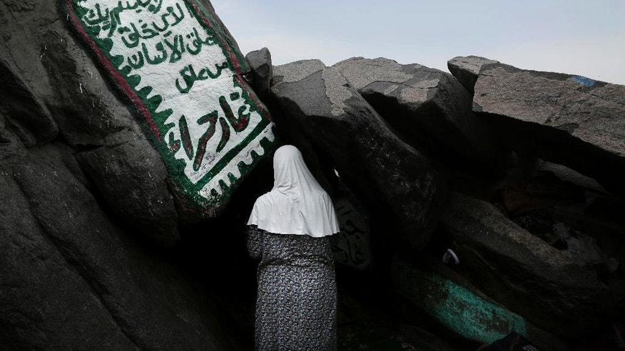 A Turkish Muslim woman prays inside Hiraa cave, where Prophet Muhammad received his first revelation from God to preach Islam, on Noor Mountain, on the outskirts of Mecca, Saudi Arabia, Friday, Sept. 9, 2016. Muslim pilgrims have begun arriving at the holiest sites in Islam ahead of the annual hajj pilgrimage in Saudi Arabia. (AP Photo/Nariman El-Mofty)