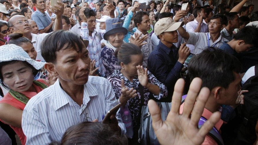 Supporters of Cambodia's main opposition Cambodia National Rescue Party listen to the party's deputy leader Kem Sokha during his speech at the party's headquarters in Phnom Penh, Cambodia, Friday, Sept. 9, 2016. Cambodia's government and its opposition faced off in court and on the streets Friday as political tensions around challenges to Prime Minister Hun Sen's long-standing autocratic rule show no signs of easing. (AP Photo/Heng Sinith)