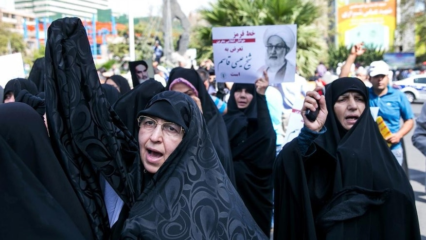 Iranian protesters chant slogans against the ruling Al Saud family of Saudi Arabia, America and Israel during a rally after weekly Friday prayer in Tehran, Iran, Friday, Sept. 9, 2016. Thousands of Iranians marched through the streets Friday to protest Saudi Arabia ahead of the hajj, a sign of soured relations between the two countries following last year's crush and stampede during the annual pilgrimage. (AP Photo/Ebrahim Noroozi)