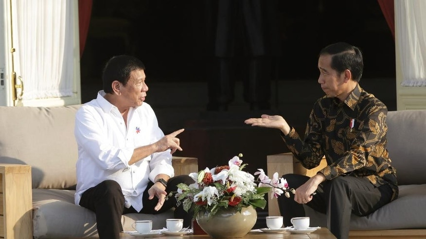 Philippine President Rodrigo Duterte, left, talks with his Indonesian counterpart Joko Widodo during their meeting at Merdeka Palace in Jakarta, Indonesia, Friday, Sept. 9, 2016. Duterte is currently on a two-day visit to the country. (AP Photo/Dita Alangkara)