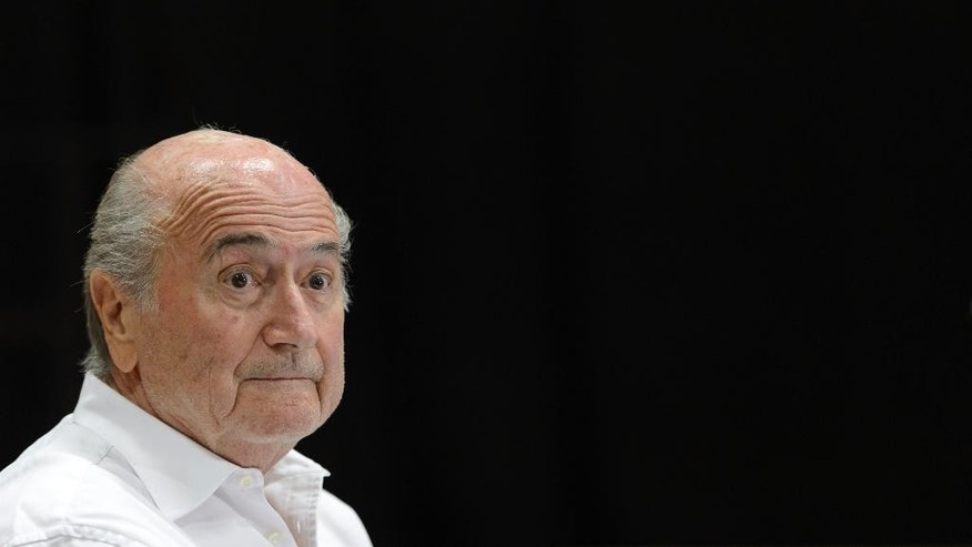 FILE - In this Aug. 22, 2015 file photo then FIFA President Sepp Blatter speaks during a news conference in Ulrichen, Switzerland. The FIFA ethics committee said Friday, Sept. 9, 2016 it opened formal proceedings against Blatter, former secretary general Jerome Valcke and former finance director Markus Kattner over million-dollar payments in their contracts — some of which were approved by other senior FIFA officials. (Laurent Gillieron/Keystone via AP, file)