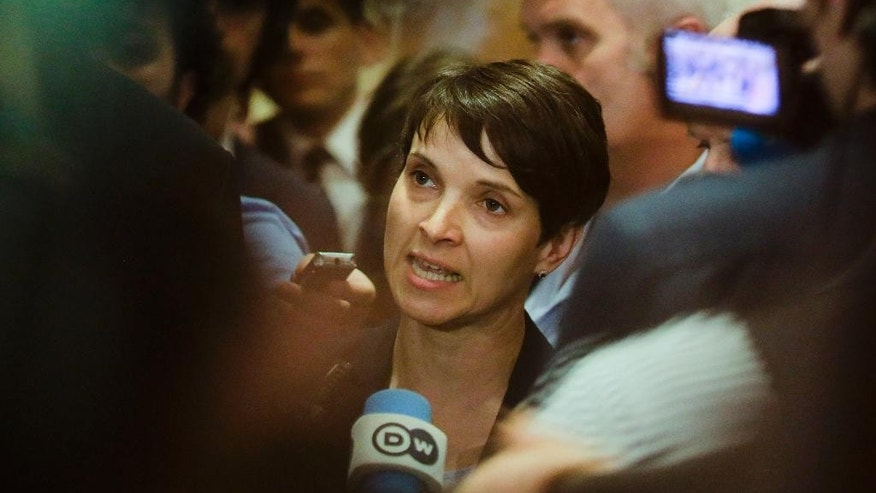 FILE - In this May 23, 2016 file photo Frauke Petry, center, chairwoman of the AfD party, Alternative for Germany, attends a joint news conference after a meeting with members of the Central Council of Muslims in Germany, in Berlin. The nationalist Alternative for Germany party's ratings were as low as 4 percent when the party ousted its founding leader amid bitter infighting last year. Fourteen months on, it has ridden discontent over Chancellor Angela Merkel's migrant policy to become a thorn in the side of all Germany's established parties.   (AP Photo/Markus Schreiber, file)
