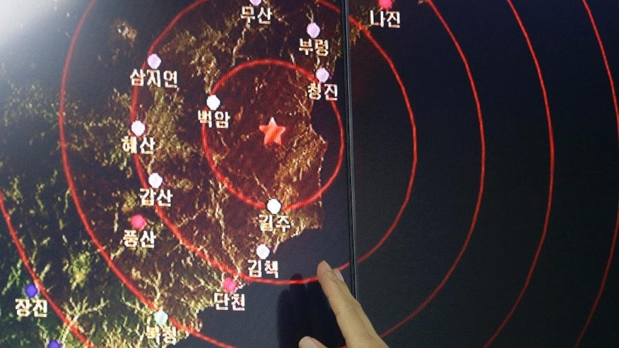 An official of the Earthquake and Volcano of the Korea Monitoring Division points at the epicenter of seismic waves in North Korea, in Seoul, South Korea, Friday, Sept. 9, 2016. South Korea's Yonhap news agency says Seoul believes North Korea has conducted its fifth nuclear test explosion. (AP Photo/Ahn Young-joon)