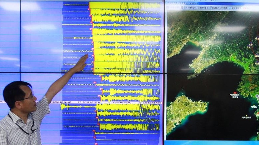 Earthquake and Volcano of the Korea Monitoring Division Director Ryoo Yong-gyu speaks in front of a screen showing seismic waves that were measured in South Korea, in Seoul, South Korea, Friday, Sept. 9, 2016. South Korea's Yonhap news agency says Seoul believes North Korea has conducted its fifth nuclear test explosion. (AP Photo/Ahn Young-joon)