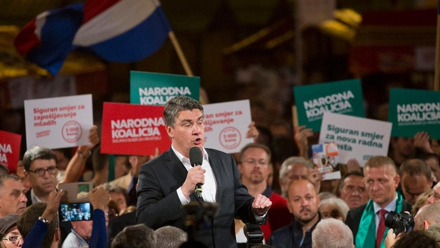 In this photo taken late Wednesday, Sept. 7, 2016, leader of the center-left coalition Zoran Milanovic talks to supporters at a rally in Zagreb, Croatia. Croats go to the polls this weekend in a snap election that, despite the country's many problems, has been more about past divisions than future challenges facing the European Union's newest member state. (AP Photo/Darko Bandic)