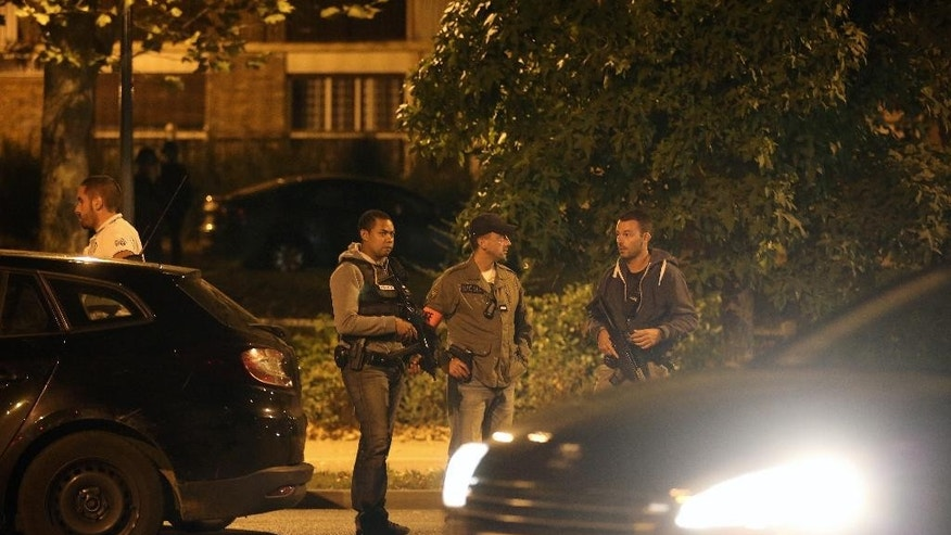 Police officers stand guard as they take part in a raid in Boussy-Saint-Antoine, east of Paris, Thursday, Sept. 8, 2016. French police detained three women planning 'imminent and violent action' after a standoff Thursday linked to a terrorism investigation into six gas canisters found in a car abandoned near Paris' Notre Dame Cathedral. (AP Photo/Thibault Camus)
