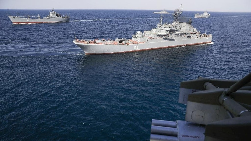 Russian navy ships during military drills at the Black Sea coast, Crimea, Friday, Sept. 9, 2016. Russia has deployed cruise missiles, multiple rocket launchers, tanks and its latest anti-aircraft system at massive military drills in Crimea. The drills which began across southern Russia and Crimea earlier this week and involve over 120,000 troops are some of the largest exercises Russia has held for years. (AP Photo/Pavel Golovkin)