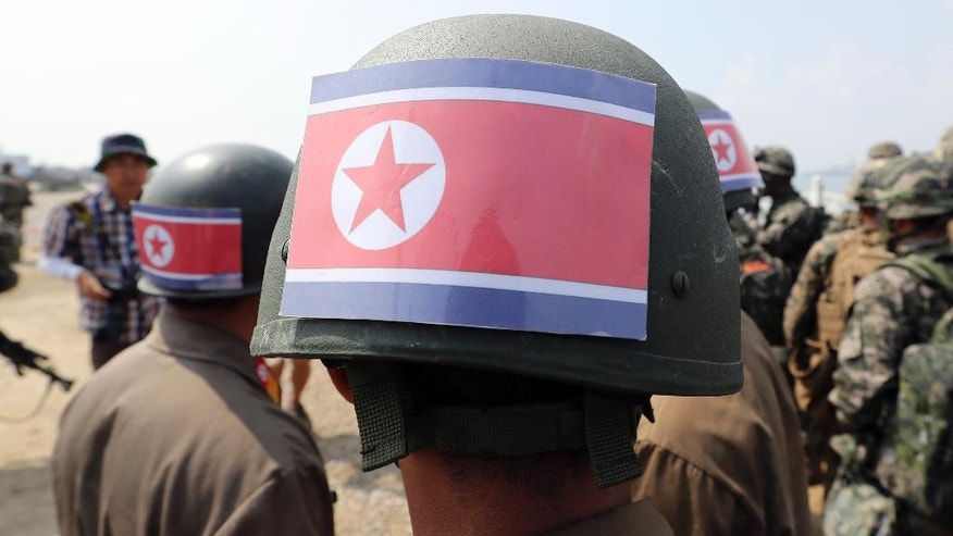 South Korean soldiers wear North Korean flags on their helmets, playing a role of North Korean soldiers after the 66th Incheon Landing Operations Commemoration ceremony in Incheon, South Korea, Friday, Sept. 9, 2016. Incheon is the coastal city where the United Nations Forces led by U.S. Gen. Douglas MacArthur landed in September, 1950 just months after North Korea invaded the South. North Korea on Friday conducted its fifth atomic test, producing its biggest-ever explosive yield, South Korean officials said after monitors detected unusual seismic activity near the North's northeastern nuclear test site. (AP Photo/Lee Jin-man)