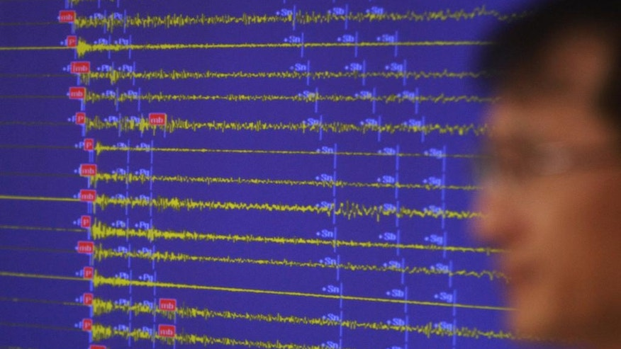 Earthquake and Volcano of the Korea Monitoring Division Director Ryoo Yong-gyu speaks in front of a screen showing seismic waves that were measured in South Korea, in Seoul, South Korea, Friday, Sept. 9, 2016. South Korea, Friday, Sep. 9, 2016. South Korea's Yonhap news agency says Seoul believes North Korea has conducted its fifth nuclear test explosion. (AP Photo/Ahn Young-joon)