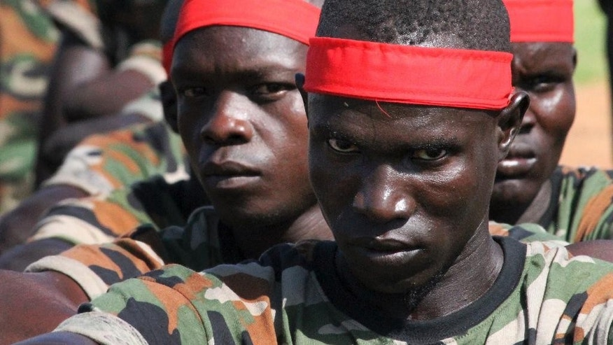 FILE - In this Monday, May 16, 2016 file photo, a group of government soldiers wait in line during a military parade celebrating the national army in Juba, South Sudan. A confidential U.N. report obtained by The Associated Press on Friday, Sept. 9, 2016 says South Sudan's deadly fighting in July was directed by the highest levels of government, and that leaders are intent on a military solution that worsens ethnic tensions. (AP Photo/Justin Lynch, File)