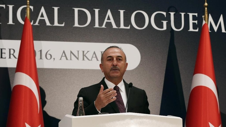 Turkey's Foreign Minister Mevlut Cavusoglu speaks to the media during a joint news conference with EU Foreign Policy Chief Federica Mogherini, European Union's Enlargement Commissioner Johannes Hahn and Turkey's EU Minister Omer Celik in Ankara, Turkey, Friday, Sept. 9, 2016. Mogherini says the 28-member bloc and Turkey agree that there can be no military solution to the Syrian conflict and that only a political solution can bring peace to the war-torn country. (AP Photo/Burhan Ozbilici)
