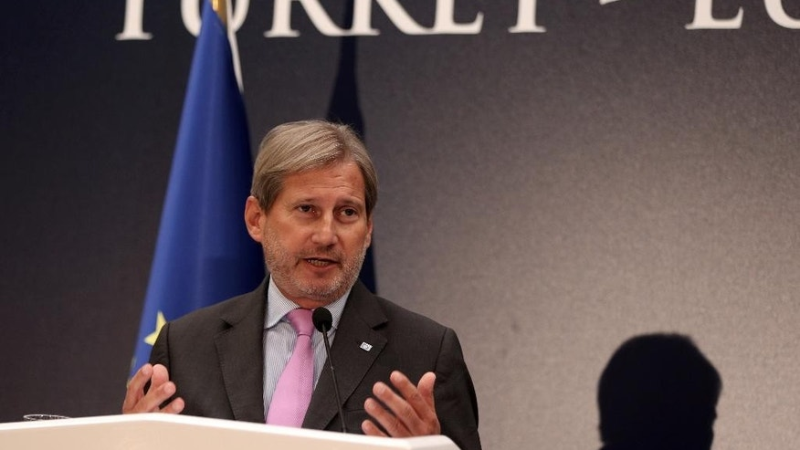 European Union's Enlargement Commissioner Johannes Hahn speaks to the media during a joint news conference with EU Foreign Policy Chief Federica Mogherini, Turkey's Foreign Minister Mevlut Cavusoglu and Turkey's EU Minister Omer Celik in Ankara, Turkey, Friday, Sept. 9, 2016. Mogherini says the 28-member bloc and Turkey agree that there can be no military solution to the Syrian conflict and that only a political solution can bring peace to the war-torn country.(AP Photo/Burhan Ozbilici)