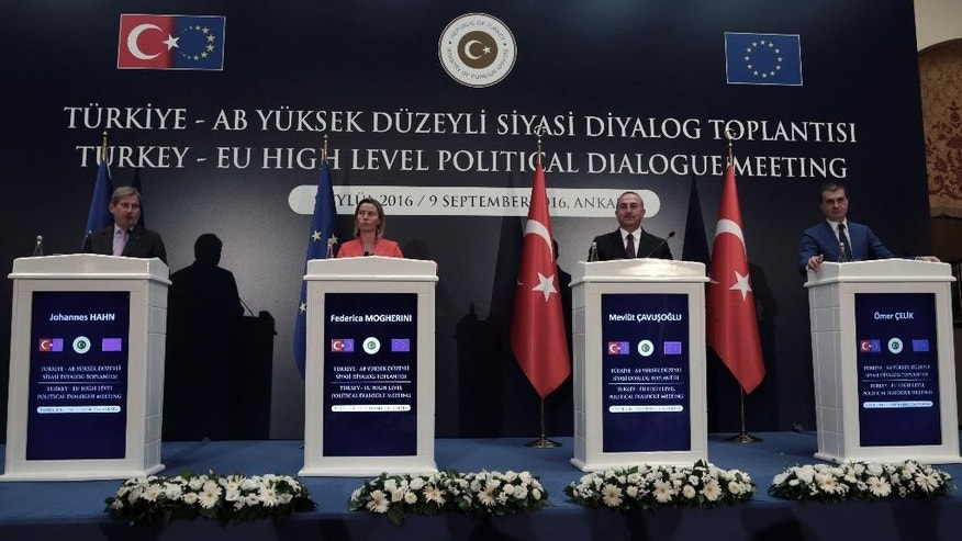 European Union's Foreign Policy Chief Federica Mogherini, second left, EU Enlargement Commissioner Johannes Hahn, left, Turkey's Foreign Minister Mevlut Cavusoglu, second right, and Turkey's EU Minister Omer Celik speak to the media after their talks in Ankara, Turkey, Friday, Sept. 9, 2016. Mogherini says the 28-member bloc and Turkey agree that there can be no military solution to the Syrian conflict and that only a political solution can bring peace to the war-torn country.(AP Photo/Burhan Ozbilici)
