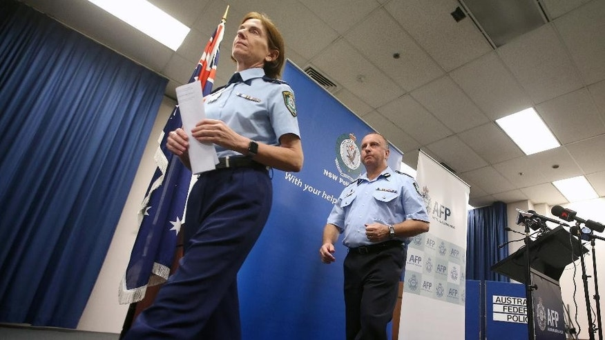 "FILE - In this May 17, 2016 file photo, New South Wales Deputy Police Commissioner Catherine Burn, left, and Australian Federal Police Acting Deputy Commissioner Neil Gaughan leave a news conference in Sydney. A man charged with committing a terrorist act and attempted murder after allegedly stabbing a man in Sydney was inspired by the Islamic State group, police said Sunday, Sept. 11. The suspect, Ihsas Khan, 22, and Wayne Greenhalgh, 59, who was stabbed several times by Khan, did not know each other, and Burn described the attack as planned and deliberate. ""This was clearly a very volatile, a very violent situation that police and the members of the community were confronted with,"" Burn told reporters. (AP Photo/Rick Rycroft, File)"
