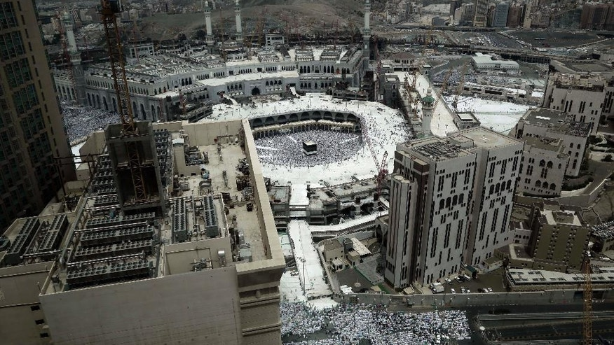 Muslim pilgrims prepare them selves for Friday prayer in front of the Kaaba, Islam's holiest shrine, at the Grand Mosque in the Muslim holy city of Mecca, Saudi Arabia, Friday, Sept. 9, 2016. Muslim pilgrims have begun arriving at the holiest sites in Islam ahead of the annual hajj pilgrimage in Saudi Arabia. (AP Photo/Nariman El-Mofty)