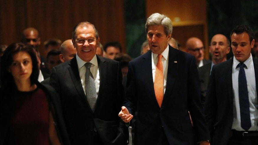 U.S. Secretary of State John Kerry, left, and Russian Foreign Minister Sergey Lavrov, walk in to their meeting room in Geneva, Switzerland, Friday, Sept. 9, 2016, to discuss the crisis in Syria.  (Kevin Lamarque/Pool Photos via AP)