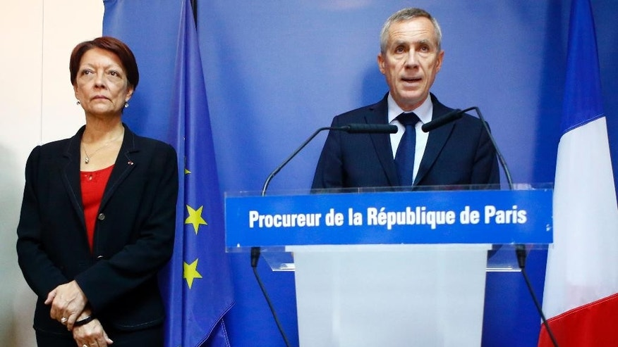 Paris Prosecutor, Francois Molins, right, flanked with Director of the Judicial Police, Mireille Ballestrazzi, left, addresses the media in Paris, Friday, Sept. 9, 2016. A failed attack involving a car loaded with gas canisters near Notre Dame Cathedral was spearheaded by a group of women that included a 19-year-old whose written pledge of allegiance to the Islamic State group was found by police, a security official said Friday. (AP Photo/Francois Mori)