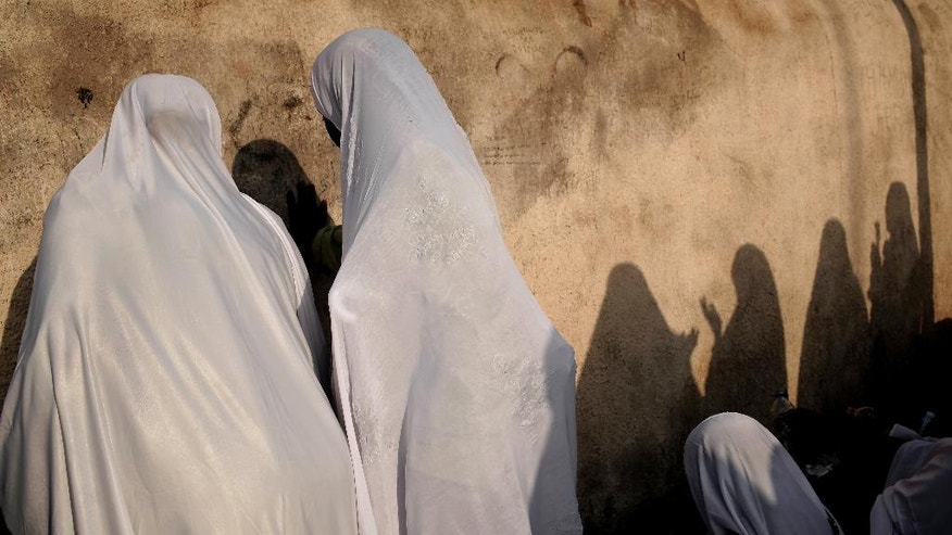 Sudanese women pray on a rocky hill known as Mountain of Mercy, on the Plain of Arafat, during the annual hajj pilgrimage, near the holy city of Mecca, Saudi Arabia, Sunday, Sept. 11, 2016. Mount Arafat, marked by a white pillar, is where Islam's Prophet Muhammad is believed to have delivered his last sermon to tens of thousands of followers some 1,400 years ago, calling on Muslims to unite. (AP Photo/Nariman El-Mofty)
