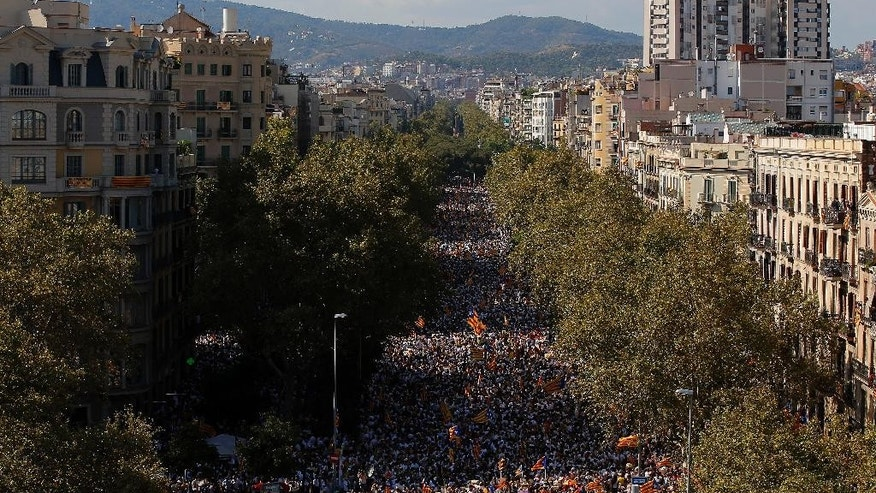 People wave 'estelada' flags, that symbolize Catalonia's independence, during a demonstration calling for the independence of Catalonia, in Barcelona, Spain, Sunday, Sept. 11, 2016. Thousands of people demonstrated in Barcelona to call for the creation of a new Mediterranean nation, as they celebrate the Catalan National Day holiday. (AP Photo/Manu Fernandez)