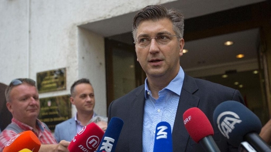 Center-right leader Andrej Plenkovic addresses the media outside a polling station in Zagreb, Croatia, Sunday, Sept. 11, 2016. Croatian citizens have started casting ballots in an early parliamentary election that is unlikely to produce a clear winner and could pave the way for more political uncertainty in the European Union's newest member state. (AP Photo/Darko Bandic)