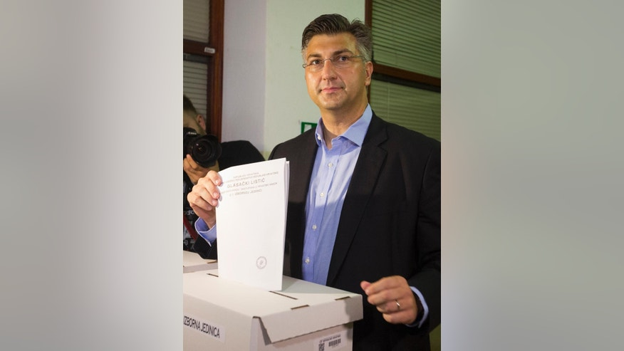 Center-right leader Andrej Plenkovic casts his ballot at a polling station in Zagreb, Croatia, Sunday, Sept. 11, 2016. Croatian citizens have started casting ballots in an early parliamentary election that is unlikely to produce a clear winner and could pave the way for more political uncertainty in the European Union's newest member state. (AP Photo/Darko Bandic)