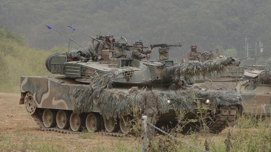 "A South Korean army's K1 tank moves during an annual exercise in Paju, South Korea, near the border with North Korea, Sunday, Sept. 11, 2016. The U.N. Security Council is strongly condemning North Korea's latest nuclear test and says it will start discussions on ""significant measures"" against Pyongyang including new sanctions. (AP Photo/Ahn Young-joon)"