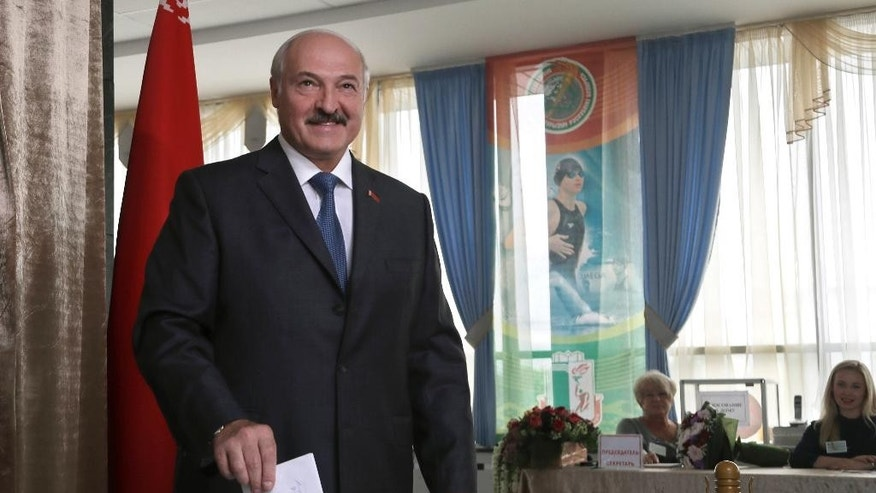 Belarusian President Alexander Lukashenko poses for photographers as he casts his ballot during parliamentary elections in Minsk, Belarus, Sunday, Sept. 11, 2016. Belarusians are casting ballots for a new parliament in the authoritarian former Soviet republic that has been making steps toward rapprochement with the West. (AP Photo/Sergei Grits)