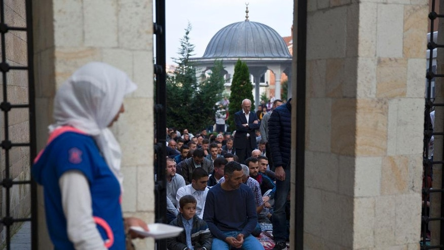 Kosovars line up outside Sultan Mehmet Fatih mosque to offer Eid al-Adha prayers in capital Pristina, Monday, Sept. 12, 2016. Muslims around the world will celebrate Eid al-Adha in local language, the Festival of Sacrifice, to mark the end of the hajj pilgrimage by slaughtering sheep, goats, cows to commemorate Prophet Abraham's readiness to sacrifice his son on God's command. (AP Photo/Visar Kryeziu)