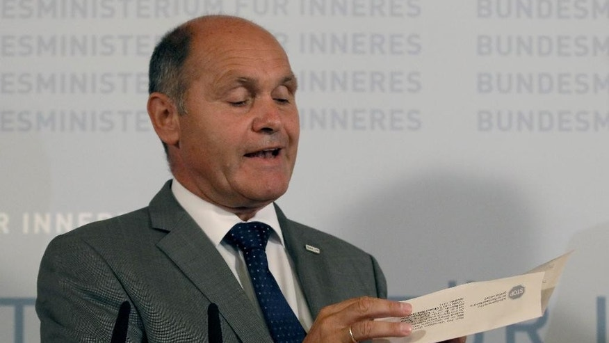 Austrian Interior Minister Wolfgang Sobotka  attends  a press conference in Vienna, Austria, Monday, Monday, Sept. 12, 2016. A second attempt to elect Austria' president this year was postponed Monday, with the country's interior minister saying the move was dictated by the discovery that the envelopes of absentee ballots frequently could not be sealed because of faulty adhesive strips. The delay must still be formalized through a still-to-be-created law. But in asking the government do draft such legislation, Interior Minister Wolfgang Sobotka effectively canceled plans to hold the vote Oct. 2.  (AP Photo/Ronald Zak)