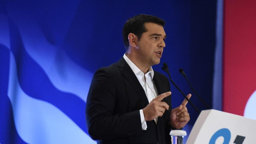 Greek Prime Minister Alexis Tsipras speaks at the 81th Thessaloniki International Trade Fair in the northern port city of Thessaloniki on Saturday, Sept. 10, 2016. Tsipras promised Saturday to deliver economic growth to a country hammered by years of economic hardship, as thousands gathered in protest at more planned austerity measures. (AP Photo/Giannis Papanikos)