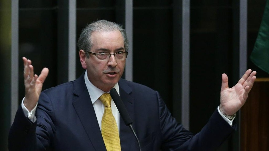 Brazil's former President of the Chamber of Deputies Eduardo Cunha speaks during the presentation of his defense in the Chamber of Deputies, in Brasilia, Brazil, Monday, Sept. 12, 2016. Prosecutors accuse Cunha of corruption and money laundering for his role in negotiating contracts for drill ships and say he received an illegal payment of $5 million. (AP Photo/Eraldo Peres)