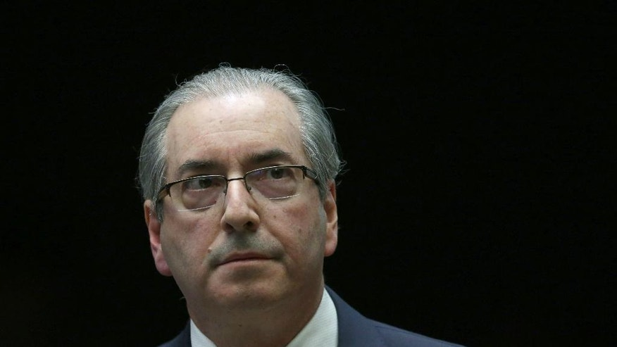 Brazil's former President of the Chamber of Deputies Eduardo Cunha takes a break during the presentation of his defense in the Chamber of Deputies, in Brasilia, Brazil, Monday, Sept. 12, 2016. Prosecutors accuse Cunha of corruption and money laundering for his role in negotiating contracts for drill ships and say he received an illegal payment of $5 million. (AP Photo/Eraldo Peres)